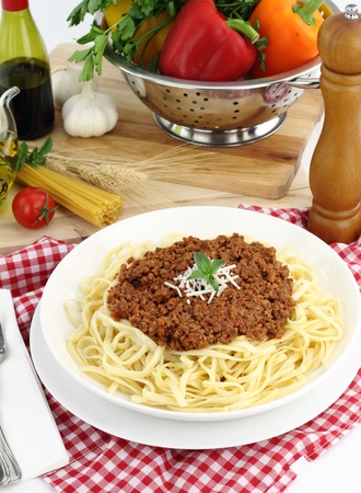 Bolognese pasta with cheese and basil photo