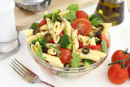 penne: Penne pasta salad with vegetables and herbs Stock Photo