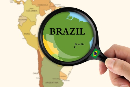brazil country: Magnifying glass over a map of Brazil Stock Photo