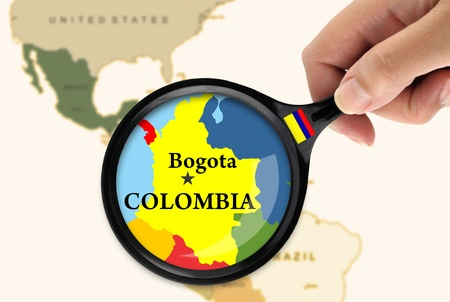 colombia flag: Magnifying glass over a map of Colombia