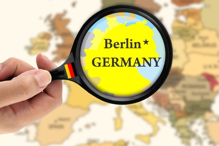Magnifying glass over a map of Germany photo