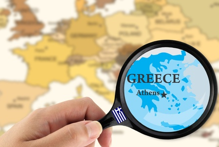 Magnifying glass over a map of Greece photo
