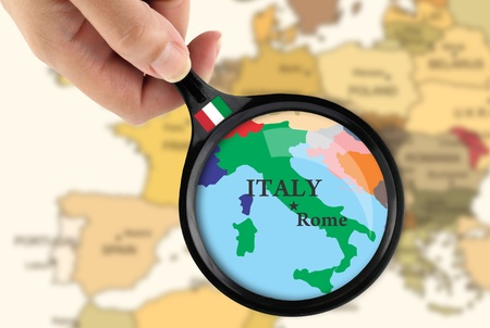 italy flag: Magnifying glass over a map of Italy Stock Photo