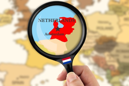 Magnifying glass over a map of Netherlands photo