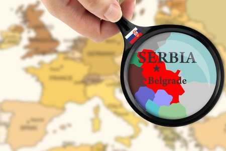 Magnifying glass over a map of Serbia Stock Photo - 10144106
