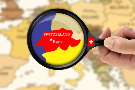 loupe: Magnifying glass over a map of Switzerland