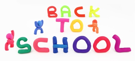 clay modeling: Plasticine figures and letters spelling back to school Stock Photo