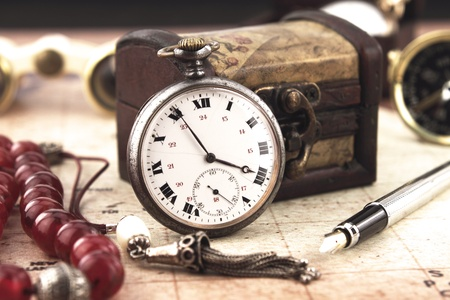 Antique Retro Pocket Clock and decoration objects photo