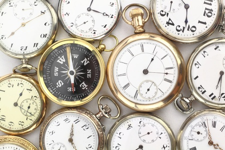 magnetic north: Various Antique pocket watches and a compass