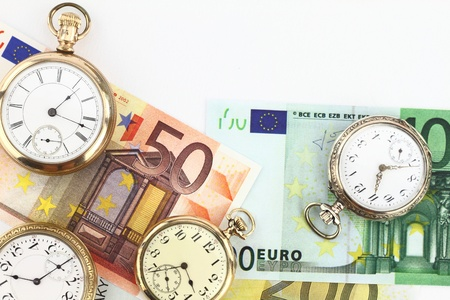 Antique pocket clocks and money photo