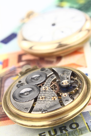 Clock mechanism with money background Stock Photo - 10416173