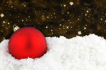 Red Christmas ball on snow  Stock Photo - 10600307