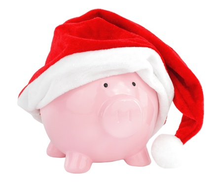Piggy bank with Santa Claus hat photo