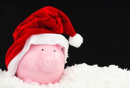 Santa Claus hucha en la nieve