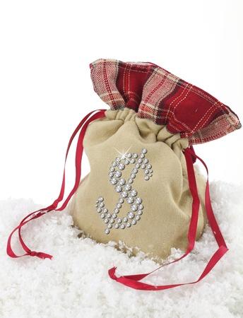 christmas savings: Dollar symbol over a sack