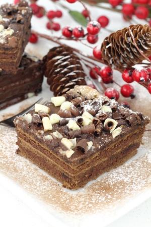 Slices of Christmas chocolate cake photo