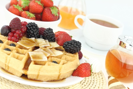 Breakfast with waffle and fruits photo