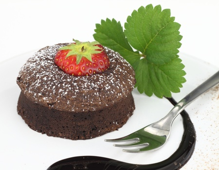 Chocolate soufflé cake on white background photo