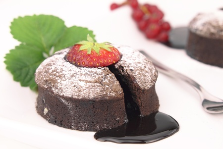 Chocolate souffle cake on white background photo