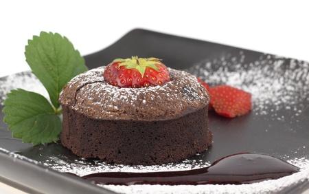Chocolate souffle cake on a dish photo