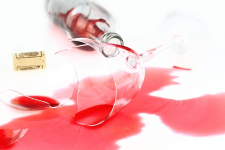 Broken wine glass and spilled red wine  photo