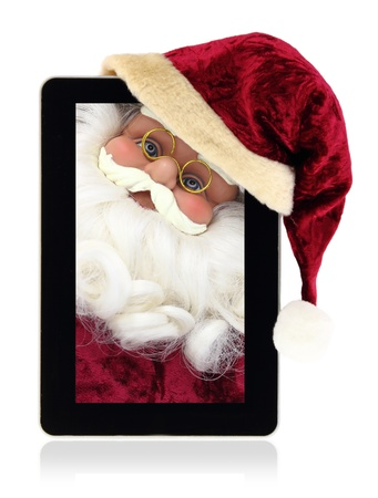Santa Claus in the Christmas tablet photo