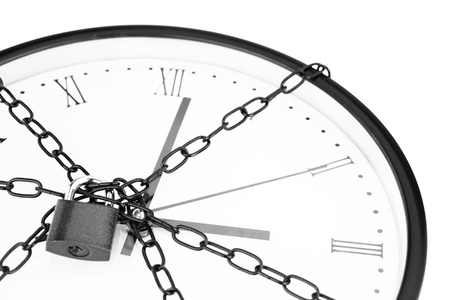 hour hand: Clock bound with chain and padlock  Stock Photo
