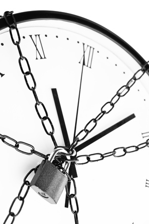 time bound: Clock bound with chain and padlock  Stock Photo