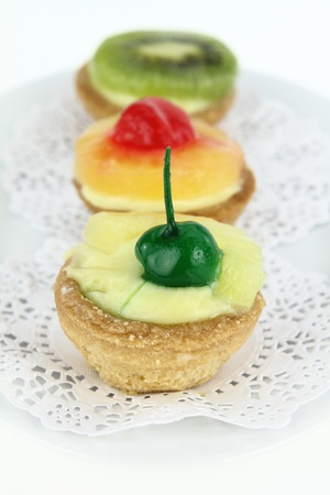 Creamy dessert tarts with fruits photo