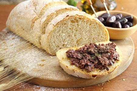 Fresh bread with olive tapenade photo