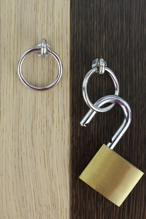 Opened padlock on wooden door photo