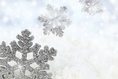 silver christmas: Snowflake on the snow background Stock Photo