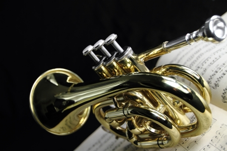 Trumpet with music sheet Stock Photo