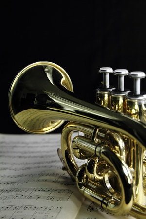 band instruments:  Trumpet with music sheet Stock Photo