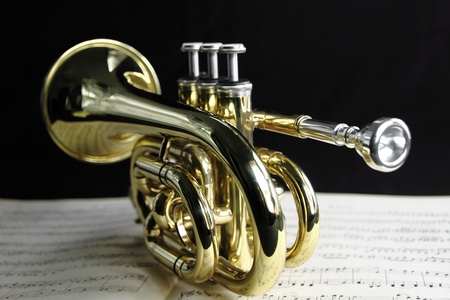 wind instrument:  Trumpet with music sheet Stock Photo