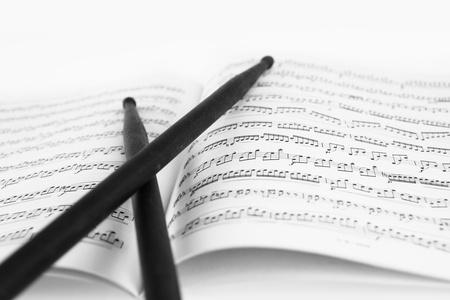 Drum sticks on the music sheet Stock Photo - 11548512