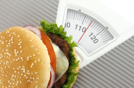 Burger on a weight scale Stock Photo - 12687536