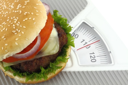 fast meal: Burger on a weight scale