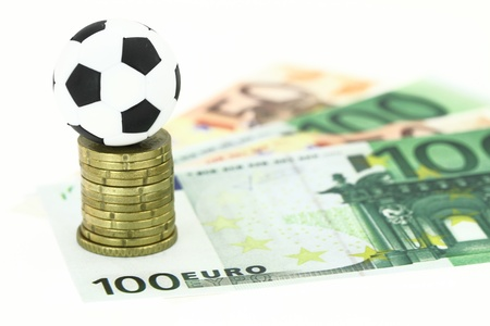 bet: Football and money Stock Photo