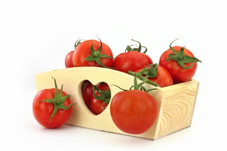 Wooden box full of tomatoes photo