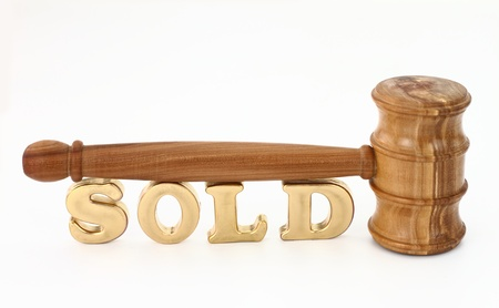 Bid: Auction concept with wooden gavel Stock Photo