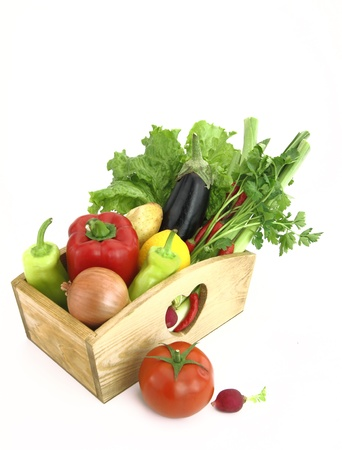 Wooden box full of fresh vegetables photo