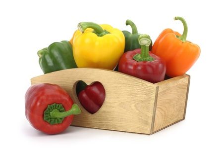 Wooden box full of bell peppers  photo