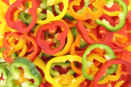 Background of fresh sliced peppers photo