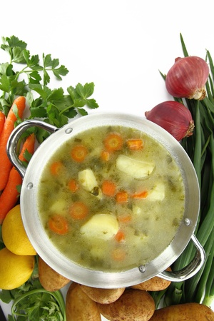 potato soup: Fresh vegetable soup in a pot with mixed vegetables around it