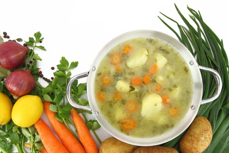 Fresh vegetable soup in a pot with mixed vegetables around it Stock Photo - 13044558