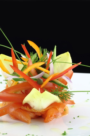 Gourmet dish. Smoked salmon with vegetables Stock Photo - 13044539