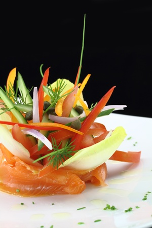 asian chef: Gourmet dish. Smoked salmon with vegetables