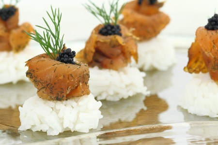 Rice with salmon and caviar photo