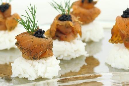 Rice with salmon and caviar photo